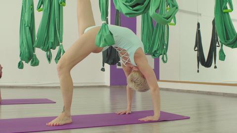 Two flexible women doing yoga asana - bridge Live Action