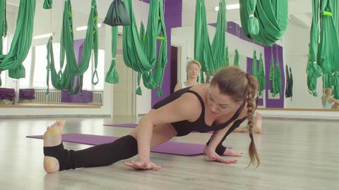 Two flexible women doing yoga different asanas Live Action