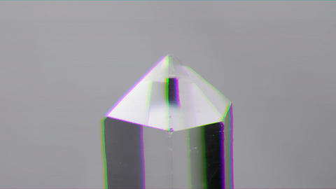 Glitch effect. Single crystal quartz on a white background. Loop Live Action