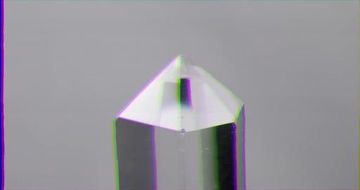 Glitch effect. Single crystal quartz on a white background. Loop Footage