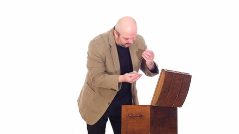 modern man opening antique chest white screen Live Action