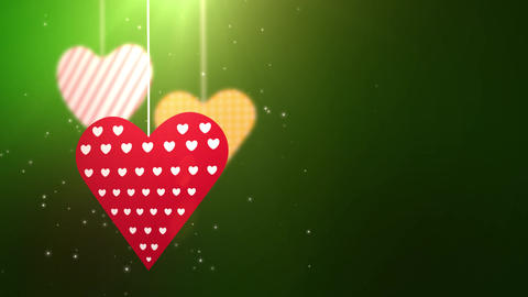 paper valentine hearts falling down hanging on string green background Animation