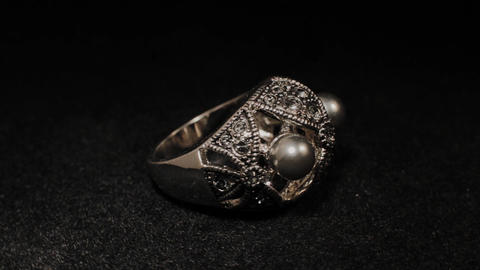 Ring on a black rotating stand. Premium Jewelery. Macro Footage