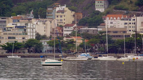 Wide panning shot of town along the coastline in Rio de Janeiro, Brazil Footage