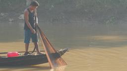 Fisher man pulling net in canoe,Battambang,Cambodia Footage