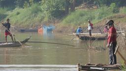 Fisherman throwing net in water,Battambang,Cambodia Footage