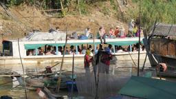 Ferry boat with tourists drift through fishing village,Battambang,Cambodia Footage