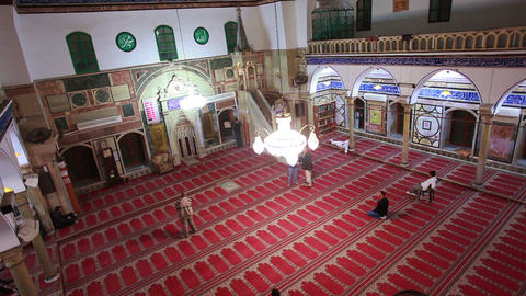 Stock Footage of a mosque that fills with men who come to pray in Israel Footage