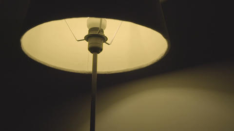 A floor lamp switching off and on Footage