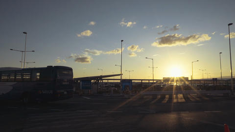 Sunset airport and a bus passing by Live Action