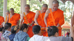 Women Giving Offerings To Monks,Vientiane,Laos stock footage