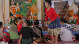 Mother Hugs Bored Child In Temple,Vientiane,Laos stock footage