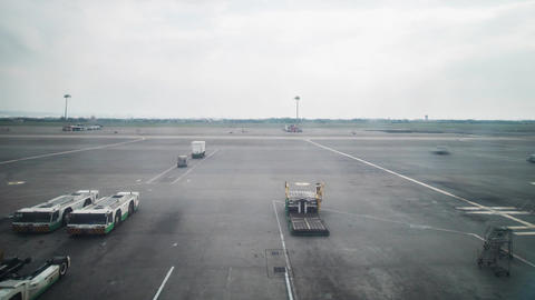 Airport Runway Tarmac Timelapse Taipei Taiwan Ground Support Vehicles Pushback T stock footage