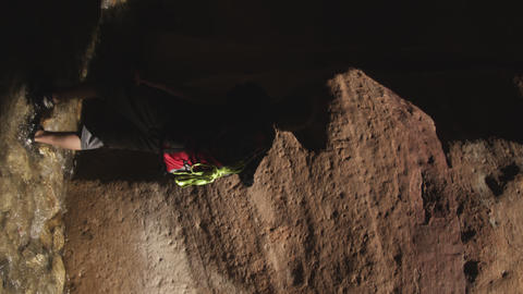 Sideways shot of a hiker walking along the canyon in Zion Narrows Footage