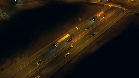 Aerial - Traffic on a freeway and roundabout at night Footage