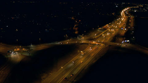 Aerial - Traffic on roundabout and highway at night Footage