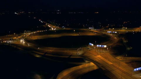 Aerial - Traffic at roundabout at night Footage