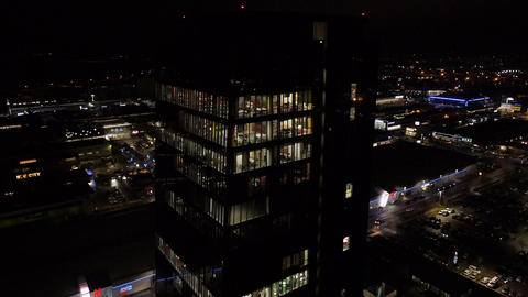 Aerial - Business building with bright illumination office interior at night Footage