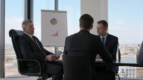 Business people discussing financial reports Footage