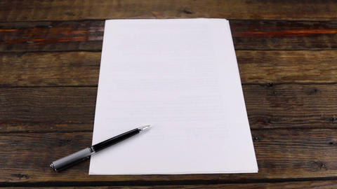 Slider shot, pen lying on a clean sheet of paper, with copy space Footage