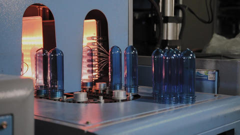 PET preforms move on heating oven line in fast speed. Plastic bottles production Footage