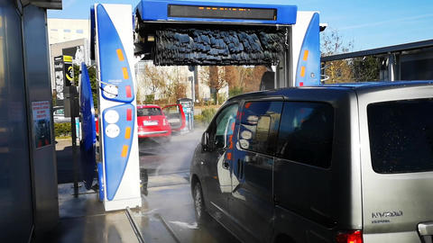 van in the mechanical carwash with brushes Live Action
