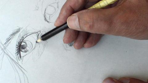 Drawing Eyes With Pencil In Sketchbook Footage