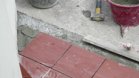 tiler who restores the laying of the sidewalk Footage