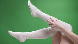 Closeup shoot of female teenage legs in cute white socks playfully moving with Footage