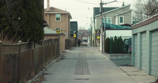 Establishing shot of an unidentifiable kid walking home from school Footage