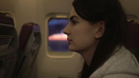 portrait shot of young woman sitting on seat of an airplane Live Action