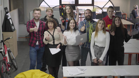 Big friendly office team smiling and showing big fingers… Stock Video Footage