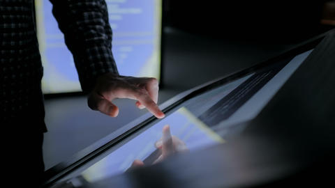 Man using interactive touchscreen display at modern history museum Live Action