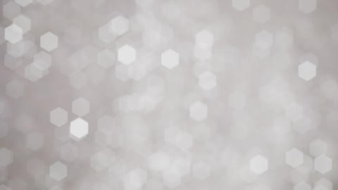 Glittering soft silver white bokeh background with flickering light particles Animation