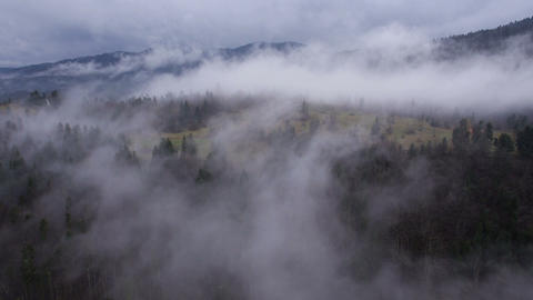 Aerial - A blanket of fog covers the landscape Footage