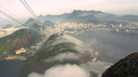 Gondola ride on a misty day over the Brazilian coastline in Rio de Janeiro, Braz Footage