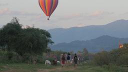 Hot Air Balloon Above Landscape, Tourists Make Selfie,Vang Vieng,Laos stock footage