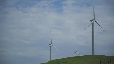 Cloudy sky above three turbines in a Californian wind farm Footage