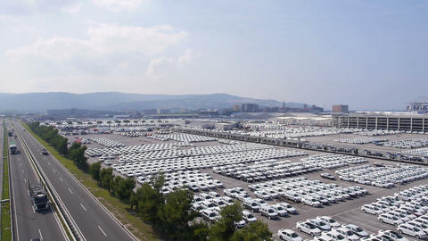Aerial - Highway Next To The Shipping Port Full Of Cars Ready To Transport stock footage