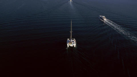Aerial - Nautical vessels sailing towards the port Live Action