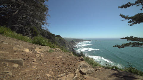 Right dolly shot above Big Sur coast Footage