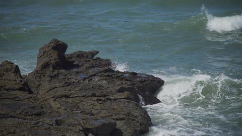 Waves splash on rocks near beach at Moon Stone Beach Footage