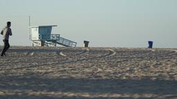 Joggers near life guard booth near the Santa Monica Pier Footage