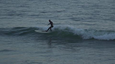 Surfers Dramatic bob in the ocean near Mesa Beach