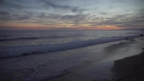 Girl runs along Mesa beach at Sunset Footage
