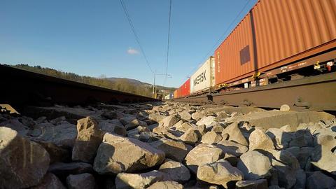 Rail track POV - Train passing beside the rail line Footage