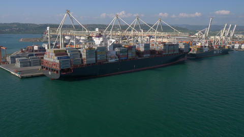 Aerial - Cargo ship at commercial dock Footage