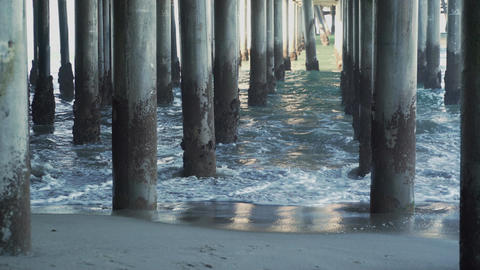 Waves hitting the pilings under the Santa Monica Pier Footage