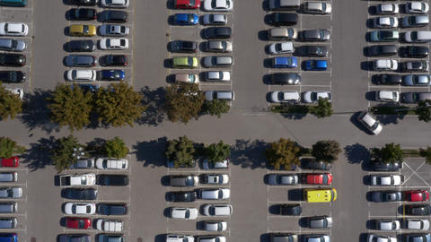Aerial, vertical - Cars in parking lot Footage