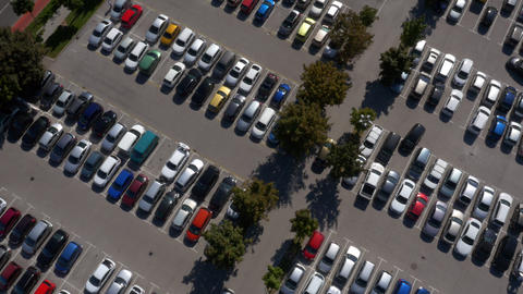 Aerial - Rotating Shot Above Shopping Center Parking Lot stock footage